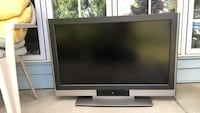 black flat screen TV with remote East Amherst, 14051