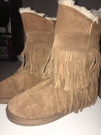 pair of brown suede fringe boots