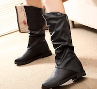 pair of black leather knee-high boots Calgary, T3J 4E8