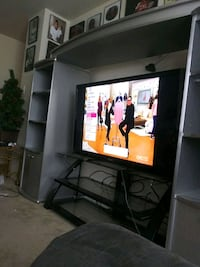 black flat screen TV with TV stand San Antonio, 78239