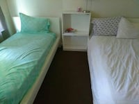 two white and green bed mattresses