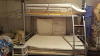 gray steel bunk bed with white mattresses