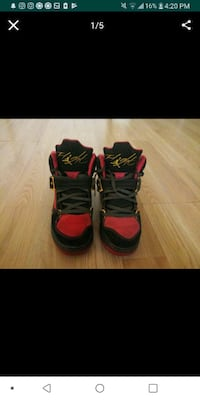 pair of red-and-black basketball shoes 2051 mi