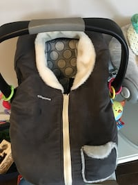 baby's black, white, and gray polka-dot vheicle seat carrier