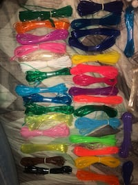assorted color of plastic clothes hangers 152 mi