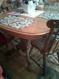 brown wooden pedestal table