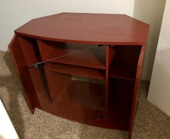 Burgundy solid tv stand with glass doors