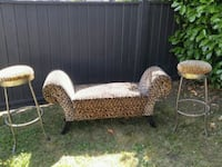 brown-and-beige leopard print sofa with two bar stools set