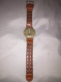 Fossil sun dial wrist watch with a real leather band