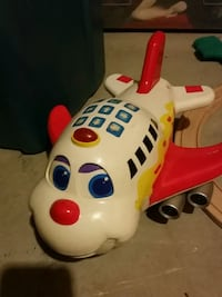 white and red plane plastic toy
