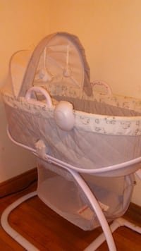 white and gray bassinet