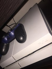 White ps4 with blue controller and grips Edmonton, T6L 4K5
