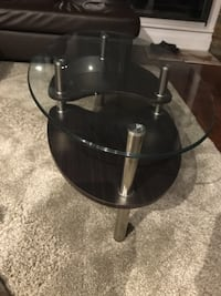 round clear glass-top table with black steel base 539 km
