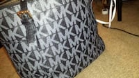 gray and black monogrammed Michael Kors leather wallet