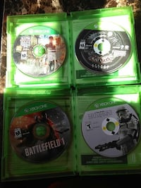 four Xbox One game disc with cases