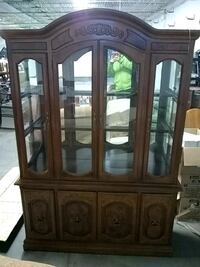 brown wooden framed glass display cabinet Minneapolis, 55413