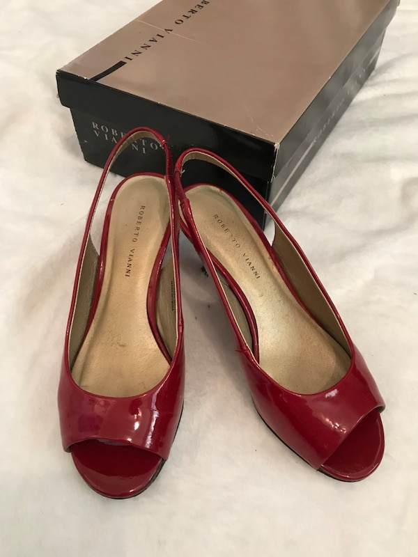 Pair of red leather peep-toe heeled shoes