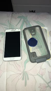 White samsung galaxy 5 smartphone with life proof case Westminster, 92683