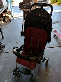 baby's red and black stroller Las Vegas, 89119