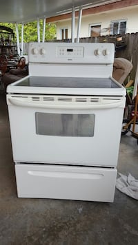 white induction stove range with oven