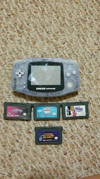 black Nintendo Game Boy Advance with game cartridges Mission, 78572