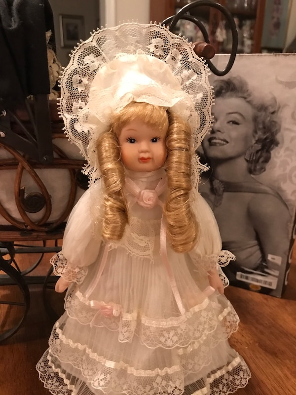 Pretty Little Porcelain Doll all dressed in lace