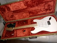 white and brown stratocaster electric guitar in ca Cleveland