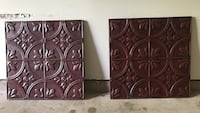 two brown metal wall decors