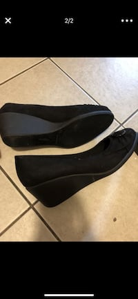 pair of women's black suede round-toe wedge shoes screenshot