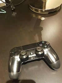 black Sony PS4 dualshock controller