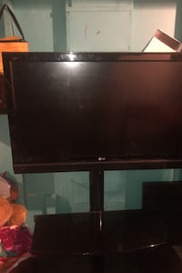 OLG flat screen Tv and Stand