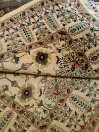 brown, red, and black floral area rug Gainesville, 20155