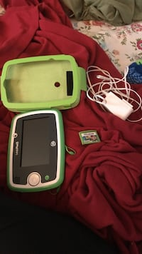 Black, white, and green leappad3 with case and charger And Jake Game