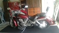 red and black touring motorcycle