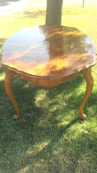 oval brown wooden family table