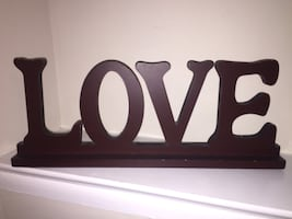 Brown wooden free-standing love letter table decor