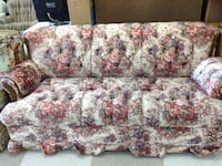 white, pink, and green floral fabric sofa