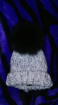 white and black knitted toque Winnipeg, R2V 0J3