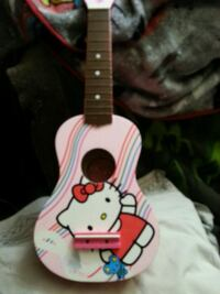 white and pink  Hello Kitty guitar Victoria, V8W