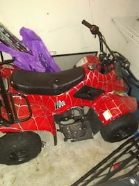 toddler's red and black ride-on ATV