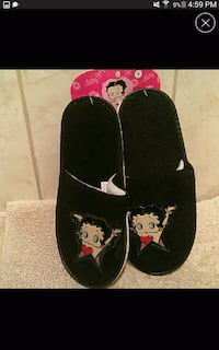 pair of black Betty Boop home slippers
