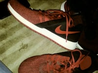 pair of red-and-black Nike running shoes Las Vegas, 89129