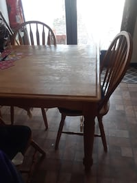 Rectangular brown wooden table with four chairs dining set Manassas, 20112