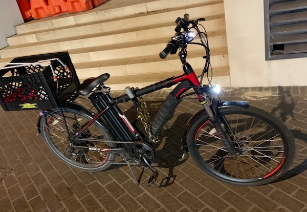 Black and red motorized bicycle