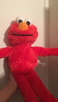 Hugging Elmo works perfect great condition smoke free home