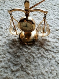 brass-colored weighing scale analog desk clock St. Catharines, L2M 4G1