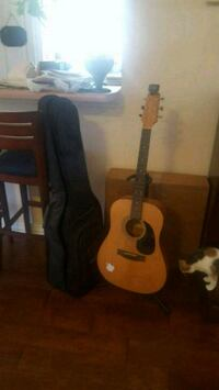 Takamine acoustic guitar with stand and carrier Garland, 75040