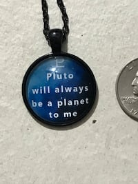 Pluto is a planet charm necklace