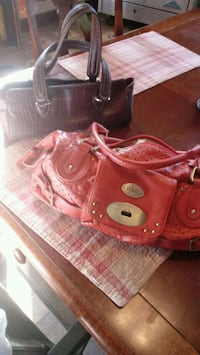 red leather tote bag and wristlet