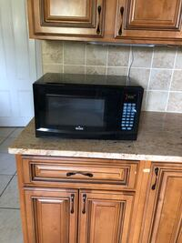 Black microwave. Works great, we are moving and don't need it anymore. Patterson, 12563